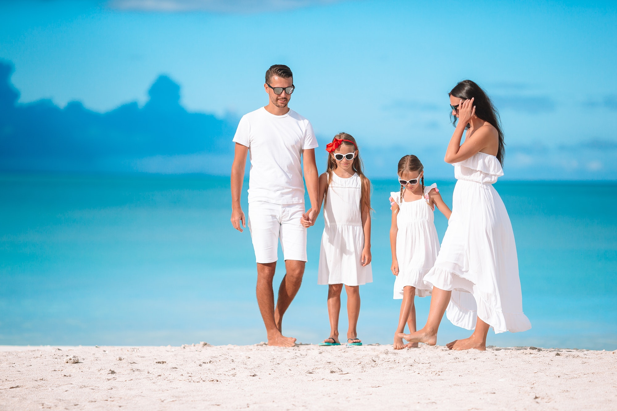 Happy beautiful family with kids on the beach
