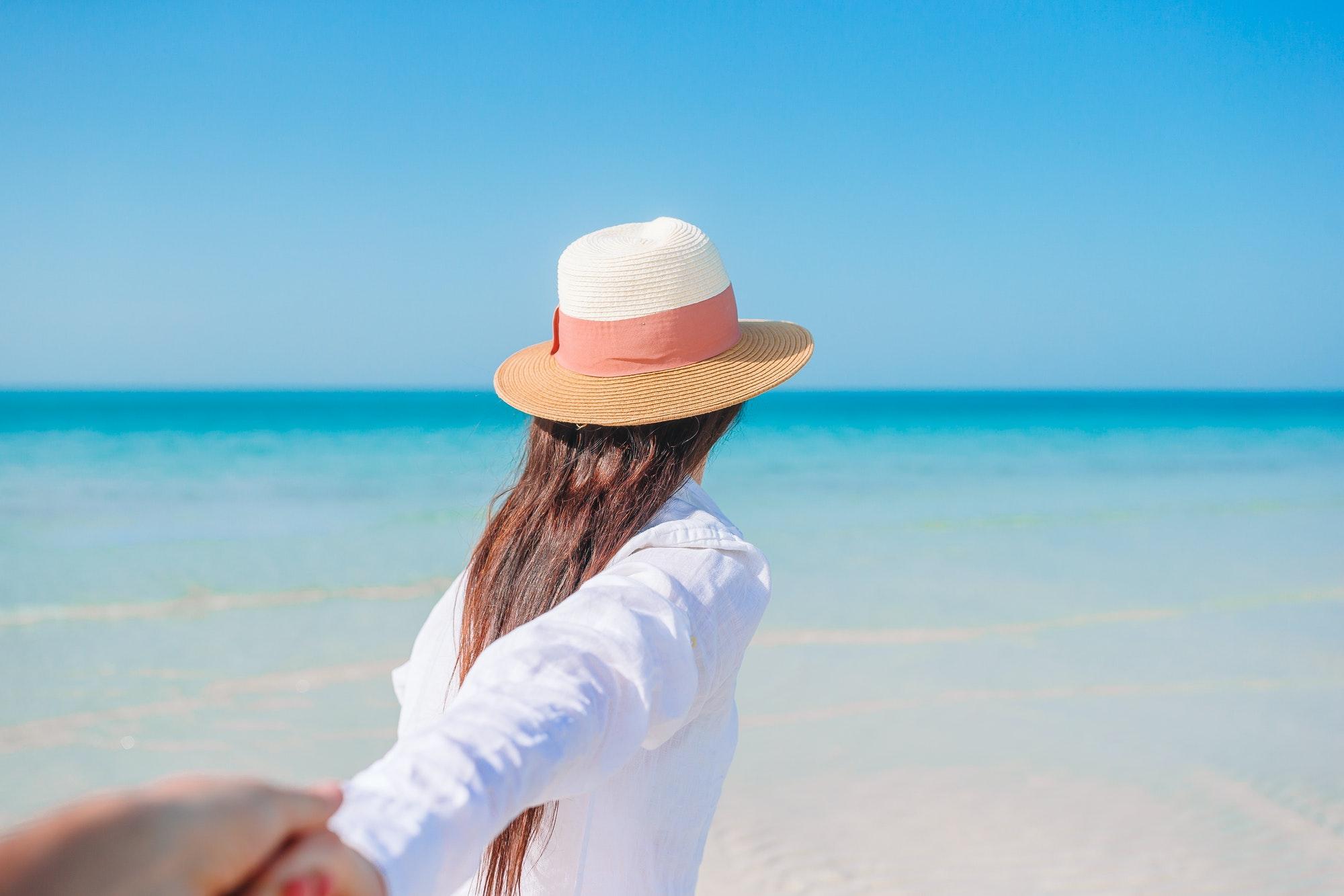 Woman laying on the beach enjoying summer holidays