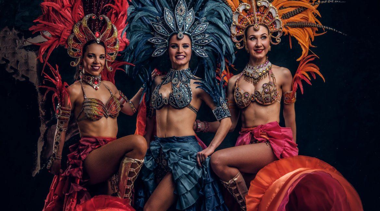 Three beautiful women in traditional brazilian carnival costumes